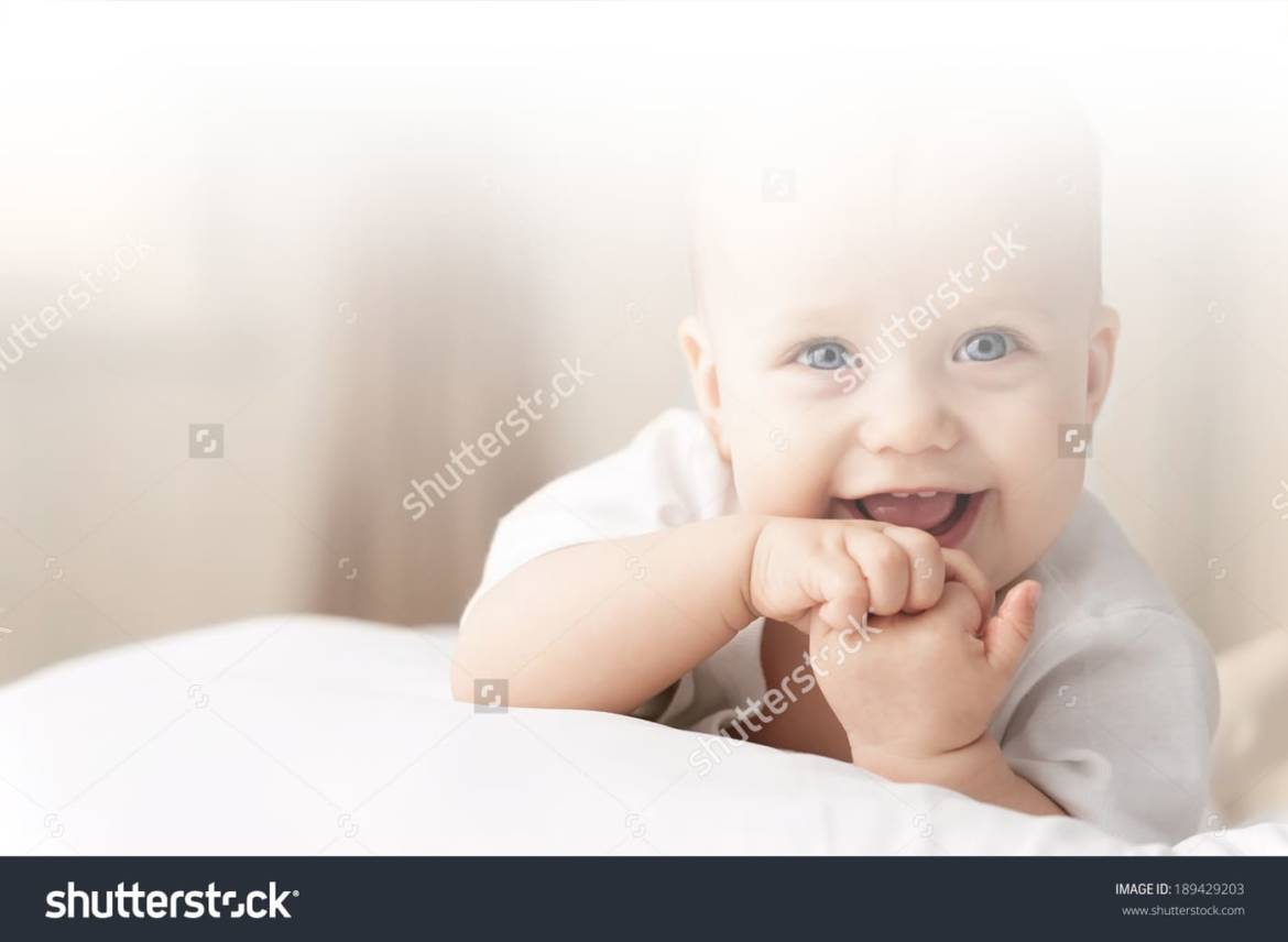 stock-photo-portrait-of-a-crawling-baby-on-the-bed-in-her-room-189429203.jpg