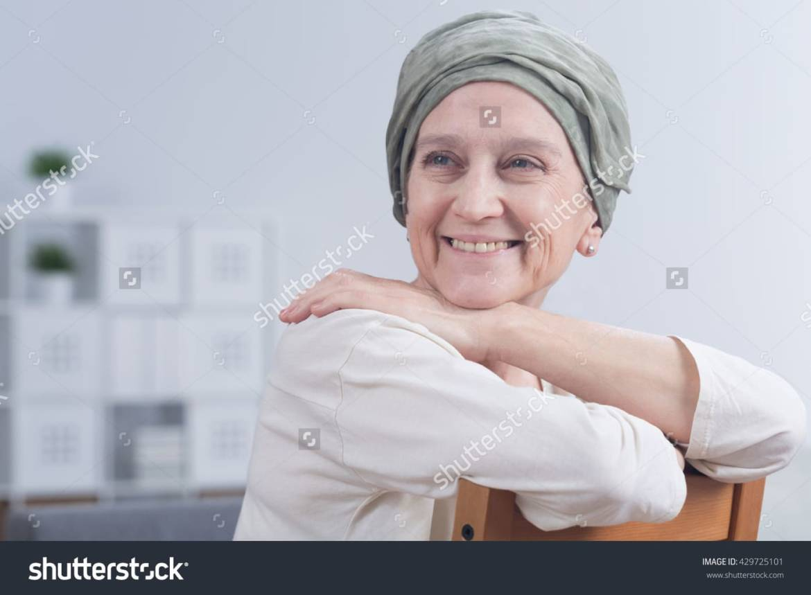 stock-photo-shot-of-a-smiling-woman-after-a-chemotherapy-429725101.jpg